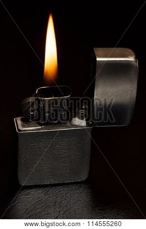 Petrol lighter on black leather