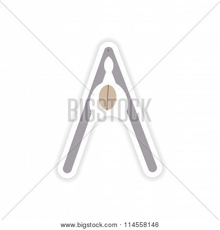 stylish paper sticker on white background nut and nutcracker