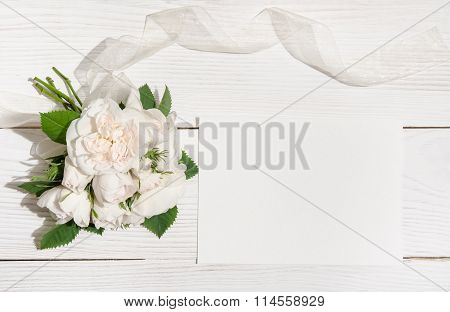 Bunch Of White Roses On White Table With Empty Card For You Text .top View