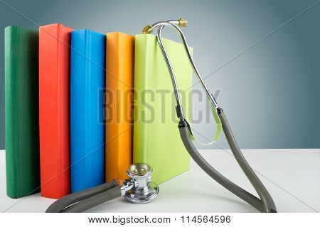 Hardback books on the table, medical  stethoscope. Medical professional education and information co