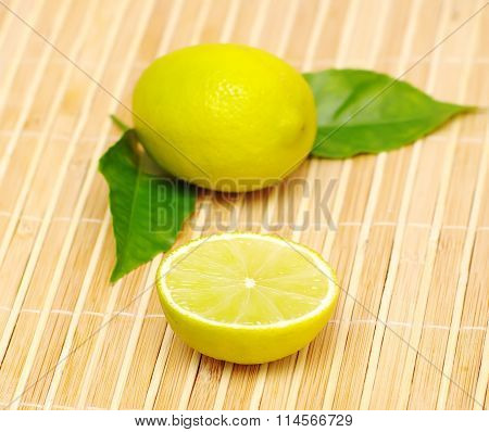 lemon fruits with green leaves