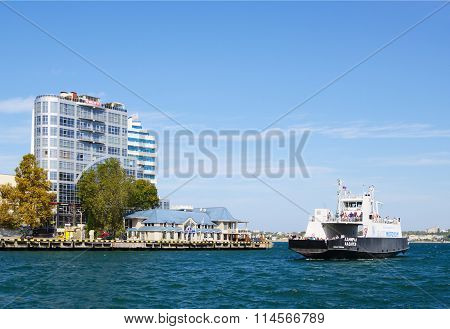 SEVASTOPOL, RUSSIA - SEPTEMBER 18, 2014: autumn view of cape Crystal and passenger ship at shore