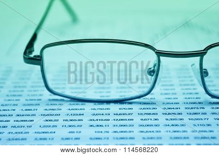 Glasses On Business Graph, Financial Concept