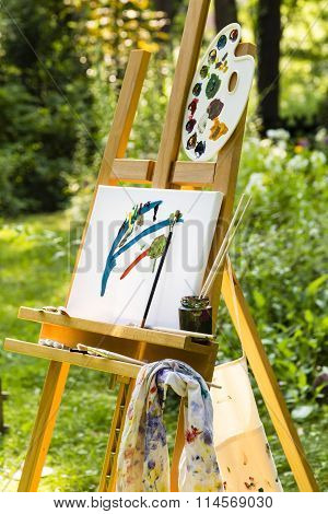 Easel With Canvas In A Garden