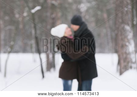 Happy couple in nature. Love story. Photo in defocusing