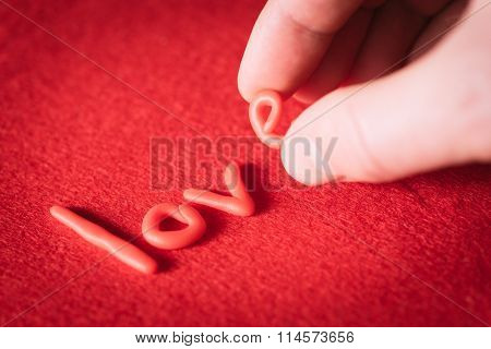 Valentines Day. Man puts the word love with red letters