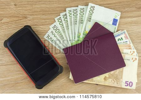 Passport and money on wooden table. Valid EURO banknotes. Illegal migration for money