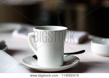 White Cup on the table.