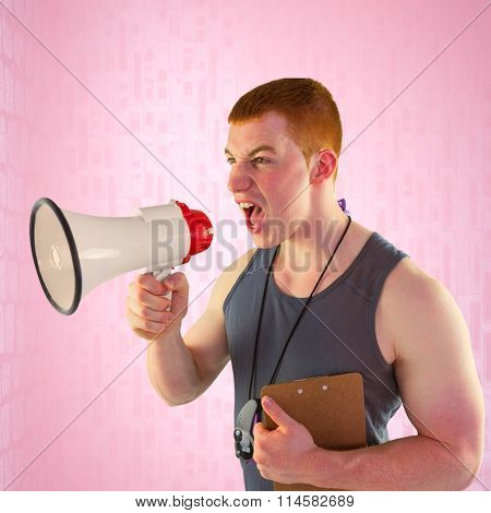 Angry personal trainer yelling through megaphone against pink background