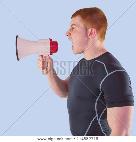Angry rugby player yelling through the megaphone against blue background