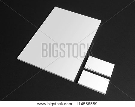 Blank stationery template with business cards on dark