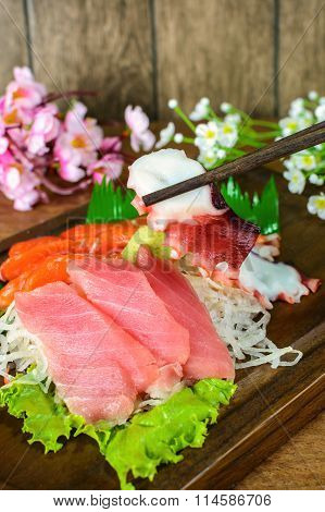 Sashimi Tuna, Salmon And Squid Japanese Food On Wooden Table