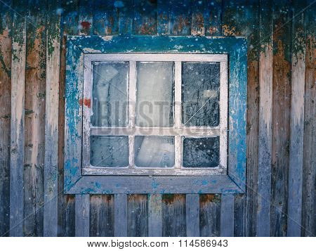 Old window with cracked paint