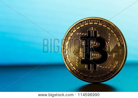 One Bitcoin On Blue Backround