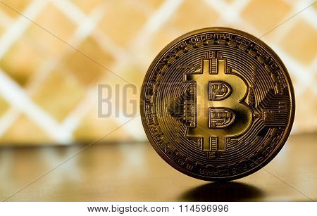 One Bitcoin On Gold Backround