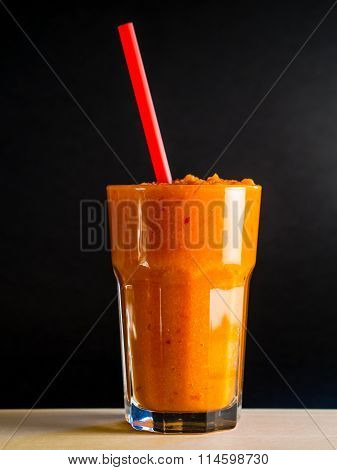 Carrot smoothie with black background