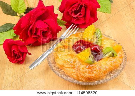 Closeup danish pastry with fruits crystal dish