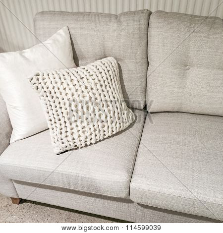 Gray Sofa With Knitted Cushion
