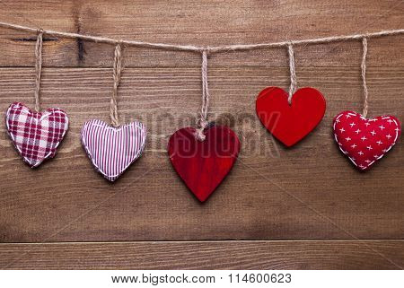 Red Hearts Hanging In A Line For Valentines Daecoration