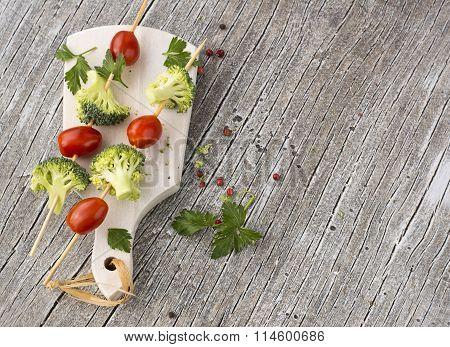 Fresh broccoli, juicy tomatoes on skewers