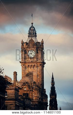 Balmoral Hotel bell tower with Scott Monument and Edinburgh city view.