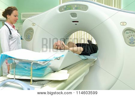 nurse and patient being scanned and diagnosed on CT (computed tomography) scanner in hospital