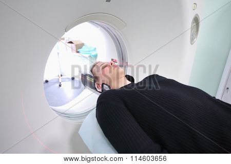 Patient examined in x-ray computed tomography CT at radiology clinic