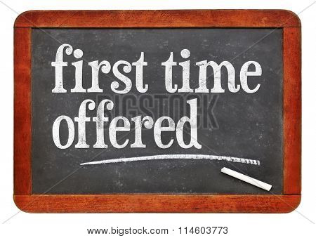 first time offered marketing slogan - white chalk text on a vintage slate blackboard