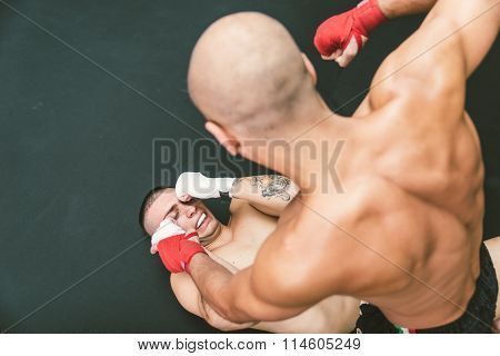 Mma Fighters Fighting On The Ground