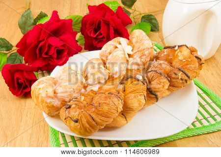 Closeup danish pastry twist on wood tabletop
