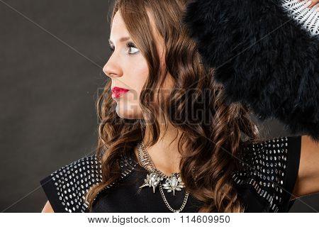 Beautiful Brunette Woman With Black Fan In Hand