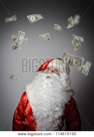 Santa Claus And Dollars.