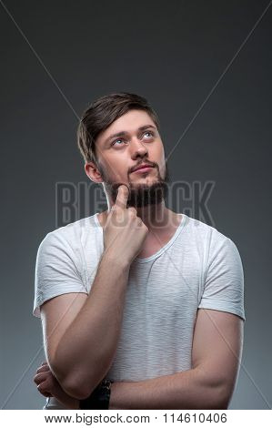 Attractive young man is dreaming about future