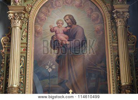 ZAGREB, CROATIA - MAY 28: Saint Joseph holding child Jesus altarpiece in the Basilica of the Sacred Heart of Jesus in Zagreb, Croatia on May 28, 2015