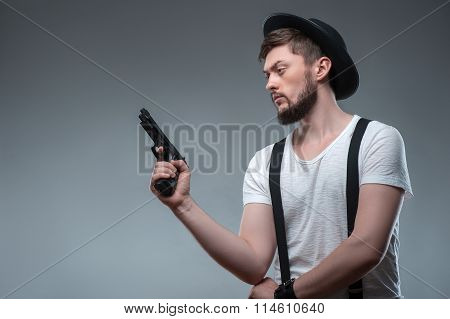 Cheerful young man with weapon and cap