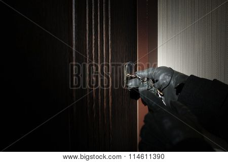 Man's Hand In A Glove Key Opens The Door