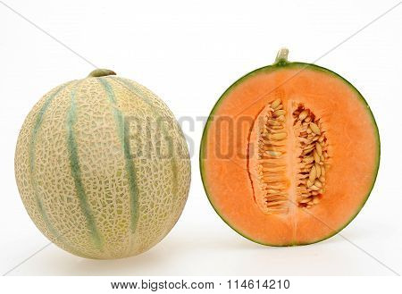 whole and half Cantaloupe melon on a white background