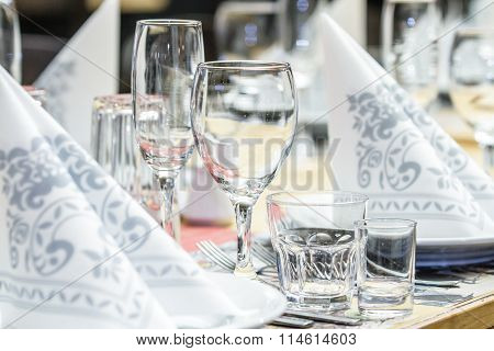 Banquet table with wineglasses and serviettes