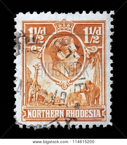 NORTHERN RHODESIA, CIRCA 1938 - Post stamp printed in UK for the Northern Rhodesia colony on Northern Rhodesia shows King Georg VI and Animals, circa 1938