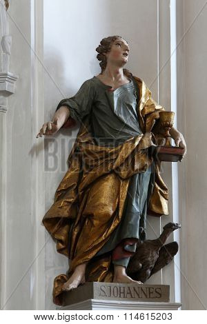ELLWANGEN, GERMANY - MAY 07: Saint John the Evangelist, Basilica of St. Vitus in Ellwangen, Germany on May 07, 2014.