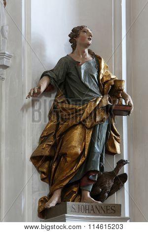 ELLWANGEN, GERMANY - MAY 07: Saint John the Evangelist, Basilica of St. Vitus in Ellwangen, Germany on May 07, 2014.
