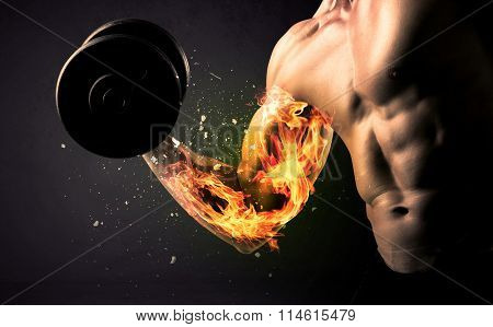 Bodybuilder athlete lifting weight with fire explode arm concept on background