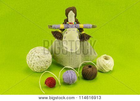A handmade doll made of straw and wool