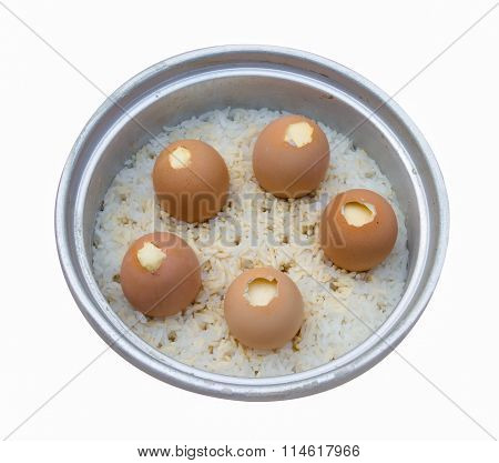 Stream Egg and rice in electric rice cooker isolated