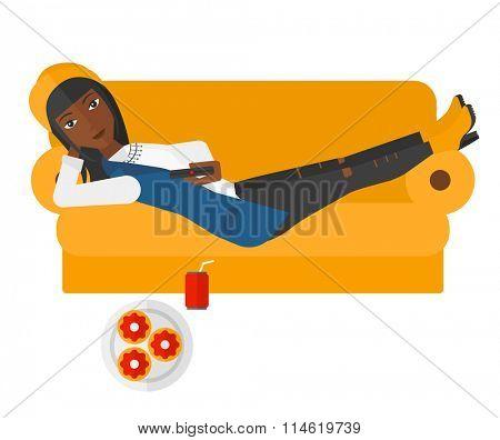 Woman lying on sofa with junk food.