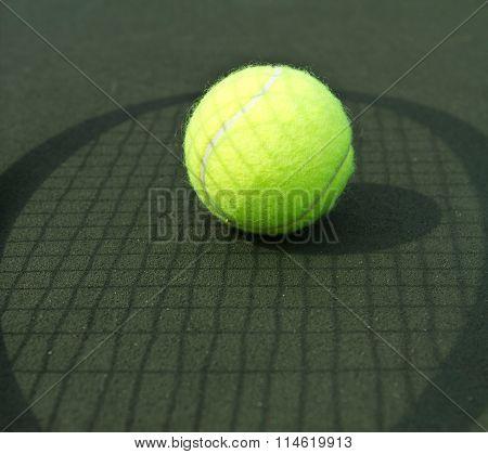 Tennis Ball and Raquet Shadow