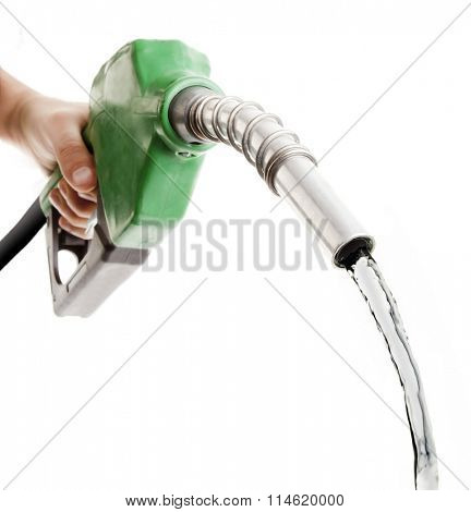 Hand holding fuel nozzle wasting gas on white