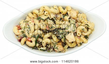 Above view of Tuscan Chicken Pasta in White Ceramic Bowl over white.