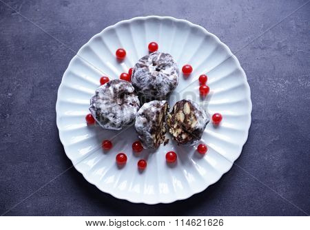 Chocolate balls with ash berry on plate, top view