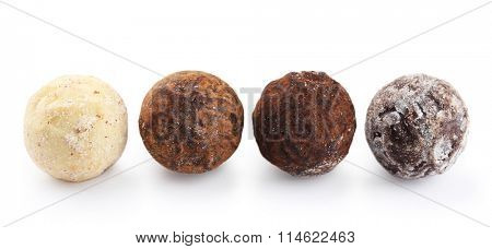 Row of chocolate truffles, isolated on white